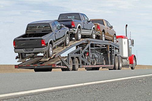 Open Transport truck delivering pickup trucks