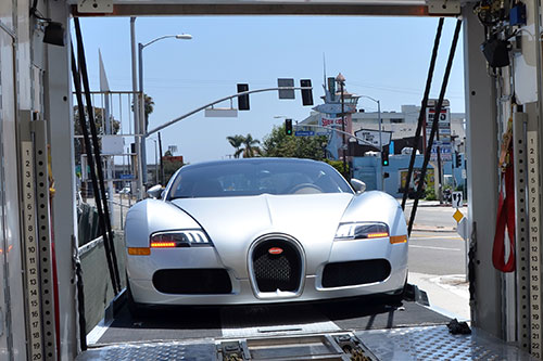 Exotic Car Being Loaded onto an Enclosed Truck