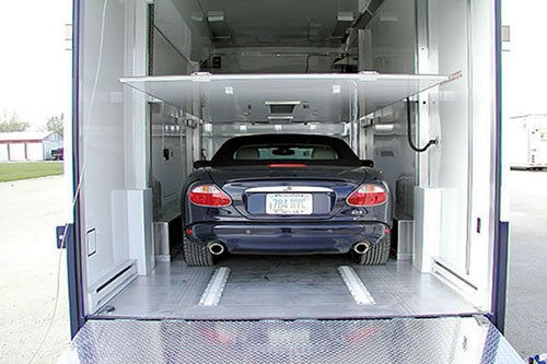 Luxury car inside of an enclosed trailer