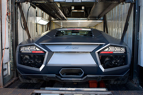 Exotic car inside of an enclosed trailer
