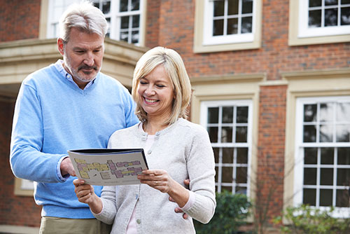 Couple looking at a home floor plan