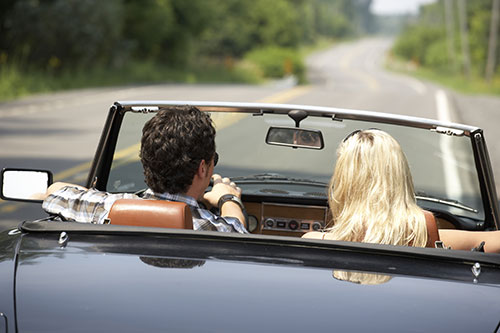 Couple taking their classic car out for a ride