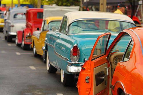 Line of classic cars at an auction